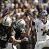 Jacksonville Jaguars quarterback Chad Henne (7) passes as Oakland Raiders linebacker Philip Wheeler (52) and defensive back Tyvon Branch (33) applies pressure during the second quarter of an NFL football game, Sunday, Oct. 21, 2012, in Oakland, Calif. (AP Photo/Marcio Jose Sanchez)