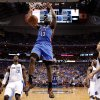 Oklahoma City\'s James Harden (13) dunks the ball as Dallas\' Ian Mahinmi (28), Jason Terry (31), and Dirk Nowitzki (41) watch during Game 4 of the first round in the NBA playoffs between the Oklahoma City Thunder and the Dallas Mavericks at American Airlines Center in Dallas, Saturday, May 5, 2012. Oklahoma City won 103-97. Photo by Bryan Terry, The Oklahoman