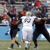 Oklahoma State\'s Clint Chelf (10) throws a pass during the Heart of Dallas Bowl football game between the Oklahoma State University (OSU) and Purdue University at the Cotton Bowl in Dallas, Tuesday,Jan. 1, 2013. Photo by Sarah Phipps, The Oklahoman