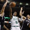 Boston Celtics\' Rajon Rondo (9) goes up to shoot between Brooklyn Nets\' Kris Humphries, left, and Deron Williams (8) in the first quarter of an NBA basketball game in Boston, Wednesday, Nov. 28, 2012. (AP Photo/Michael Dwyer)