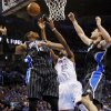 Orlando\'s Tobias Harris (12), Oklahoma City\'s Kevin Durant (35) and Orlando\'s Nikola Vucevic (9) try to rebound the ball during an NBA basketball game between the Oklahoma City Thunder and the Orlando Magic at Chesapeake Energy Arena in Oklahoma City, Friday, March 15, 2013. Photo by Nate Billings, The Oklahoman