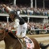 Photo - REACTION / WINNER / HORSE RACING: Calvin Borel riding Mine That Bird reacts after winning the 135th Kentucky Derby horse race at Churchill Downs Saturday, May 2, 2009, in Louisville, Ky. (AP Photo/James Crisp) ORG XMIT: KYD229