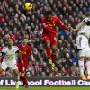 Photo - Liverpool's Daniel Sturridge, centre right, scores his second goal against Swansea City during their English Premier League soccer match at Anfield Stadium, Liverpool, England, Sunday Feb. 23, 2014. (AP Photo/Jon Super)