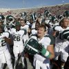 Michigan State fullback Trevon Pendleton, front, along with teammates celebrate after the Spartans defeated Indiana 31-27 in an NCAA college football game Saturday, Oct. 6, 2012, in Bloomington, Ind. (AP Photo/Darron Cummings)