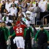 Photo - Oregon wide receiver Charles Nelson (6) makes a catch as South Dakota's Chris Tyler defends during the second quarter of an NCAA college football game in Eugene, Ore., Saturday, Aug. 30, 2014. (AP Photo/Ryan Kang)