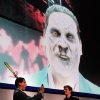 FILE - In this June 5, 2012 publicity file photo provided by Nintendo of America, Reggie Fils-Aime, Nintendo of America\'s President and Chief Operating Officer, left, tests out an interactive feature of