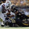 Oklahoma State running back Joseph Randle, left, runs for an 18-yard gain as Missouri\'s Matt White and Zaviar Gooden (25) defend during the first half of an NCAA college football game Saturday, Oct. 22, 2011, in Columbia, Mo. (AP Photo/Jeff Roberson)