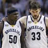 Memphis Grizzlies center Marc Gasol (33), of Spain, talks with forward Zach Randolph (50) during the first half against the Oklahoma City Thunder in Game 4 of a second-round NBA basketball playoff series on Monday, May 9, 2011, in Memphis, Tenn. (AP Photo/Wade Payne)