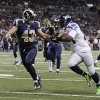 Photo -   Seattle Seahawks running back Marshawn Lynch (24) runs past St. Louis Rams strong safety Craig Dahl for an 18-yard touchdown run during the first half of an NFL football game Sunday, Sept. 30, 2012, in St. Louis. (AP Photo/Tom Gannam)