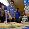 Oklahoma City Thunder general manager Sam Presti, left, watches Thunder player Nick Collison cut a cake at Ranchwood Nursing Home in Yukon on Nov. 27 during the team' 1,000th community appearance. Photo by Chris Landsberger, The Oklahoman Archives