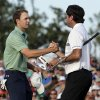 Photo - Bubba Watson, right, shakes hands with Jordan Spieth after winning the Masters golf tournament Sunday, April 13, 2014, in Augusta, Ga. (AP Photo/Charlie Riedel)