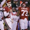 CELEBRATE / CELEBRATION: Oklahoma\'s Sam Bradford (14) pumps his fist after throwing a touchdown pass during the first half of the Big 12 Championship college football game between the University of Oklahoma Sooners (OU) and the University of Missouri Tigers (MU) on Saturday, Dec. 6, 2008, at Arrowhead Stadium in Kansas City, Mo. PHOTO BY BRYAN TERRY, THE OKLAHOMAN ORG XMIT: KOD