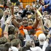 Oklahoma State\'s Brian Williams celebrates with fans following an NCAA college basketball game between the Oklahoma State University Cowboys (OSU) and the Missouri Tigers (MU) at Gallagher-Iba Arena in Stillwater, Okla., Wednesday, Jan. 25, 2012. Oklahoma State won 79-72. Photo by Bryan Terry, The Oklahoman