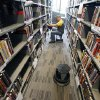 Circulation Clerk Jeremy Titsworth sorts books Monday in the new Northwest Library in Oklahoma City. Photo By Paul Hellstern, The Oklahoman