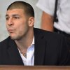Former New England Patriot football player Aaron Hernandez, listens to procedings in a court in Attleboro, Mass., Thursday, Aug. 22, 2013. Hernandez was indicted on first-degree murder and weapons charges in the death of a friend whose bullet-riddled body was found in an industrial park about a mile from the ex-player\'s home. (AP Photo/Josh Reynolds)