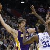 Los Angeles Lakers\' Pau Gasol, left, looks to pass away from Golden State Warriors\' Mickell Gladness (32) and Dominic McGuire during the first half of an NBA basketball game Wednesday, April 18, 2012, in Oakland, Calif. (AP Photo/Ben Margot)