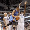 Oklahoma City\'s Russell Westbrook (0) shoots a lay up as Dallas\' Brendan Haywood (33) defends during the pre season NBA game between the Dallas Mavericks and the Oklahoma City Thunder at the American Airlines Center in Dallas, Sunday, Dec. 18, 2011. Photo by Sarah Phipps, The Oklahoman