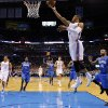 Oklahoma City\'s Russell Westbrook (0) shoots a lay up in front of Orlando\'s Jameer Nelson (14) during the NBA basketball game between the Oklahoma City Thunder and the Orlando Magic at the Chesapeake Energy Arena, Sunday, Dec. 15, 2013. Photo by Sarah Phipps, The Oklahoman