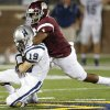 Edmond Memorial\'s Ashton Antwine brings down Edmond North\'s Carson Taber during their high school football game at Wantland Stadium in Edmond, Friday, September 6, 2013. Photo by Bryan Terry, The Oklahoman