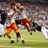 OSU\'s Josh Stewart (5) leaps for the end zone while defended by UTSA\'s Blake Terry (52) and Crosby Adams II (4) as OSU\'s Charlie Moore (17) blocks UTSA\'s Triston Wade (7) in the second quarter during a college football game between the University of Texas at San Antonio Roadrunners (UTSA) and the Oklahoma State University Cowboys (OSU) at the Alamodome in San Antonio, Saturday, Sept. 7, 2013. Stewart reached the end zone on a second effort after the leap. Photo by Nate Billings, The Oklahoman