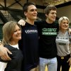 Photo - Channing Meyer and his mother Liz Meyer, left, and Corbin Cleveland and his mother Christina Cleveland pose for photographs after a signing day assembly at Norman North High School on Wednesday, Feb. 6, 2013, in Norman, Okla.  Meyer will play for the Merchant Marine Academy and Cleveland will play for Oklahoma Baptist University.   Photo by Steve Sisney, The Oklahoman
