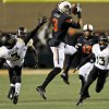 Oklahoma State\'s Marcell Ateman (3) makes a catch between Baylor\'s Demetri Goodson (3) and Terrell Burt (13) in the first quarter during a college football game between the Oklahoma State University Cowboys (OSU) and the Baylor University Bears (BU) at Boone Pickens Stadium in Stillwater, Okla., Saturday, Nov. 23, 2013. Photo by Nate Billings, The Oklahoman