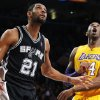 Los Angeles Lakers\' Kobe Bryant (24) and San Antonio Spurs\' Tim Duncan (21) watch a shot by Duncan in the first half of an NBA basketball game in Los Angeles, Tuesday, Nov. 13, 2012. (AP Photo/Jae C. Hong)