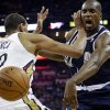 Thunder forward Serge Ibaka, right, is fouled by Pelicans center Alexis Ajinca in the first half Monday in New Orleans. AP Photo