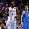 Photo - REACTION: Oklahoma City's Serge Ibaka (9) reacts beside Dallas' Dirk Nowitzki (41) during an NBA basketball game between the Oklahoma City Thunder and the Dallas Mavericks at Chesapeake Energy Arena in Oklahoma City, Thursday, Dec. 27, 2012.  Oklahoma City won 111-105. Photo by Bryan Terry, The Oklahoman