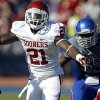 OU\'s Keith Ford (21) fumbles the ball in front of KU\'s Michael Reynolds (55) during the college football game between the University of Oklahoma Sooners (OU) and the University of Kansas Jayhawks (KU) at Memorial Stadium in Lawrence, Kan., Saturday, Oct. 19, 2013. Oklahoma won 34-19. Photo by Bryan Terry, The Oklahoman