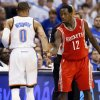 Oklahoma City's Russell Westbrook, left, brushes away the hand of Houston's Patrick Beverley after Westbrook got up from being knocked to the floor as Beverley defended him during Game 2 on Wednesday. Photo by Nate Billings, The Oklahoman