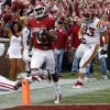 Photo - Jalen Saunders (8) scores on a punt return in the second-quarter against Iowa State on Saturday at Gaylord Family-Oklahoma Memorial Stadium in Norman. Saunders' return is the third-longest in OU history behind Darrell Royal (96 yards) and Eddie Hinton (93). Photo by Steve Sisney, The Oklahoman