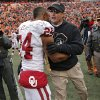 Oklahoma State coach Mike Gundy congratulates Oklahoma\'s Brennan Clay (24) during the Bedlam college football game between the Oklahoma State University Cowboys (OSU) and the University of Oklahoma Sooners (OU) at Boone Pickens Stadium in Stillwater, Okla., Saturday, Dec. 7, 2013. Photo by Chris Landsberger, The Oklahoman