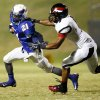 Millwood\'s Janari Glover (21) tries to avoid Prime Prep\'s Craig Moore (6) on a carry during a high school football game between Millwood and Prime Prep Academy in Oklahoma City, Friday, Sept. 14, 2012. Photo by Nate Billings, The Oklahoman