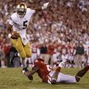 Notre Dame\'s Everett Golson (5) tries to get past OU\'s Demontre Hurst (6) during the college football game between the University of Oklahoma Sooners (OU) and the Notre Dame Fighting Irish at Gaylord Family-Oklahoma Memorial Stadium in Norman, Okla., Saturday, Oct. 27, 2012. Oklahoma lost 30-13. Photo by Bryan Terry, The Oklahoman