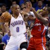 L.A. CLIPPERS: Oklahoma City\'s Russell Westbrook (0) tries to get past the Clippers\' Chris Paul (3) during an NBA basketball game between the Oklahoma City Thunder and the Los Angeles Clippers at Chesapeake Energy Arena in Oklahoma City, Wednesday, Nov. 21, 2012. Photo by Bryan Terry, The Oklahoman