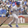 Los Angeles Dodgers\' Bobby Abreu watches his double during the second inning of a baseball game against the Chicago Cubs in Chicago, Saturday, May 5, 2012. (AP Photo/Nam Y. Huh)