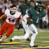 Edmond Santa Fe\'s Phillip Sumpter runs past Lawton\'s Taylor Wattenberger for a touchdown during their high school football game at Wantland Stadium in Edmond, Okla., Thursday, October 11, 2012. Photo by Bryan Terry, The Oklahoman
