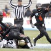 Oklahoma State\'s Justin Gilbert (4) celebrates a fumble recovery during the Heart of Dallas Bowl football game between the Oklahoma State University (OSU) and Purdue University at the Cotton Bowl in Dallas, Tuesday,Jan. 1, 2013. Photo by Sarah Phipps, The Oklahoman