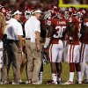 Head coach Bob Stoops and his brother Mike, defensive coordinator, talks with their defense during the second half of a college football game where the University of Oklahoma Sooners (OU) lost 24-19 to the Kansas State University Wildcats (KSU) at Gaylord Family-Oklahoma Memorial Stadium, Saturday, September 22, 2012. Photo by Steve Sisney, The Oklahoman