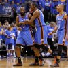 Oklahoma City\'s James Harden (13), Kevin Durant (35), and Russell Westbrook celebrate during Game 4 of the first round in the NBA playoffs between the Oklahoma City Thunder and the Dallas Mavericks at American Airlines Center in Dallas, Saturday, May 5, 2012. Oklahoma City won 103-97. Photo by Bryan Terry, The Oklahoman
