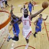 Houston Rockets\' James Harden (13) goes up for a dunk as Oklahoma City Thunder\'s Serge Ibaka (9) defends during the first quarter of an NBA basketball game, Thursday, Jan. 16, 2014, in Houston. (AP Photo/David J. Phillip)