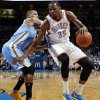 Oklahoma City\'s Kevin Durant (35) takes the ball past Denver\'s Randy Foye (4) during an NBA basketball game between the Oklahoma City Thunder and the Denver Nuggets at Chesapeake Energy Arena in Oklahoma City, Monday, Nov. 18, 2013. Photo by Nate Billings, The Oklahoman