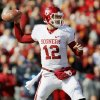 Oklahoma\'s Landry Jones (12) passes during a college football game between the University of Oklahoma (OU) and Iowa State University (ISU) at Jack Trice Stadium in Ames, Iowa, Saturday, Nov. 3, 2012. Photo by Nate Billings, The Oklahoman