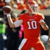 Oklahoma State\'s Clint Chelf (10) passes during a college football game between the Oklahoma State University Cowboys (OSU) and the Texas Christian University Horned Frogs (TCU) at Boone Pickens Stadium in Stillwater, Okla., Saturday, Oct. 19, 2013. Photo by Nate Billings, The Oklahoman