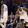 Oklahoma City\'s\' Serge Ibaka (9) celebrates a three pointer with Kevin Durant (35) during the NBA game between the Oklahoma City Thunder and the Phoenix Suns at theChesapeake Energy Arena, Friday, Feb. 8, 2013.Photo by Sarah Phipps, The Oklahoman