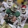 Oklahoma\'s Frank Alexander (84) and Corey Nelson (7) chase Baylor\'s Robert Griffin III (10) during the second half of the college football game in which the University of Oklahoma Sooners (OU) was defeated 45-38 by the Baylor Bears (BU) at Floyd Casey Stadium on Saturday, Nov. 19, 2011, in Waco, Texas. Photo by Steve Sisney, The Oklahoman