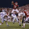 Oklahoma\'s Sterling Shepard (3) leaps over Kansas State\'s Nigel Malone (24) during the college football game between the University of Oklahoma Sooners (OU) and the Kansas State University Wildcats (KSU) at the Gaylord Family-Memorial Stadium on Saturday, Sept. 22, 2012, in Norman, Okla. Photo by Chris Landsberger, The Oklahoman