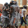 Oklahoma State\'s Charlie Moore (17) celebrates after a touchdown with Oklahoma State\'s Blake Jackson (18) as West Virginia\'s Doug Rigg (47) during a college football game between Oklahoma State University (OSU) and West Virginia University at Boone Pickens Stadium in Stillwater, Okla., Saturday, Nov. 10, 2012. Oklahoma State won 55-34. Photo by Bryan Terry, The Oklahoman