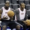 Miami Heat center Joel Anthony and forward James Jones watch a drill during practice, Monday, June 11, 2012, in Oklahoma City. Game 1 of NBA basketball finals between the Heat and Oklahoma City Thunder is scheduled for Tuesday. (AP Photo/Sue Ogrocki) ORG XMIT: OKKJ124